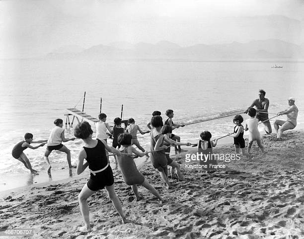 Children playing on the beach in 1928