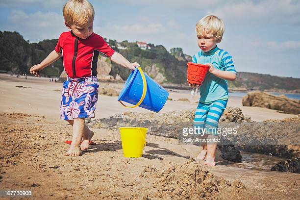 children playing on the beach - children only stock pictures, royalty-free photos & images