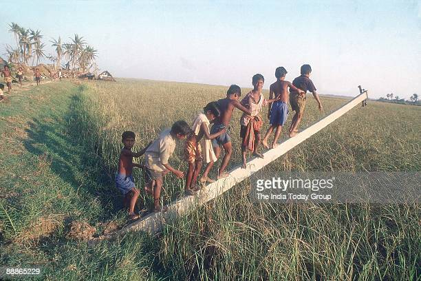 Children Playing on the Damaged Electric Pole after the Cyclone in Orissa