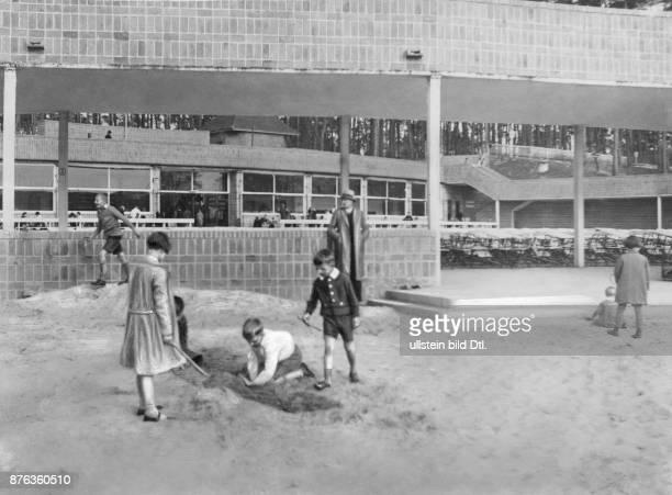 Children playing on the playground of the lekeside beach resort 1931 Vintage property of ullstein bild