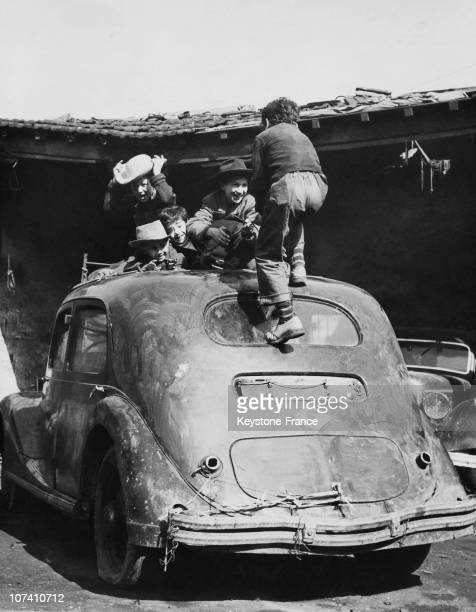 Children Playing On The Roof Of A Car In Paris