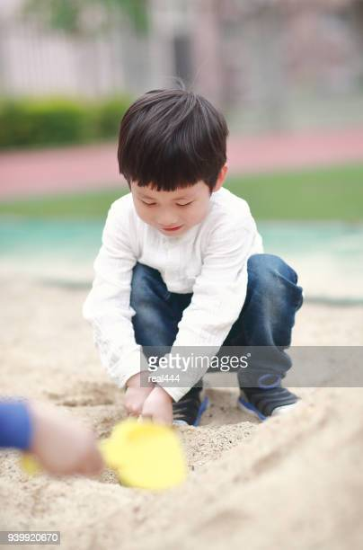 Children playing on the Sandbox