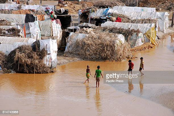 Children playing on the sandy water in their living space in Jaflong stone quarry About 1520 thousands of landless migrant are now living in Jaflong...