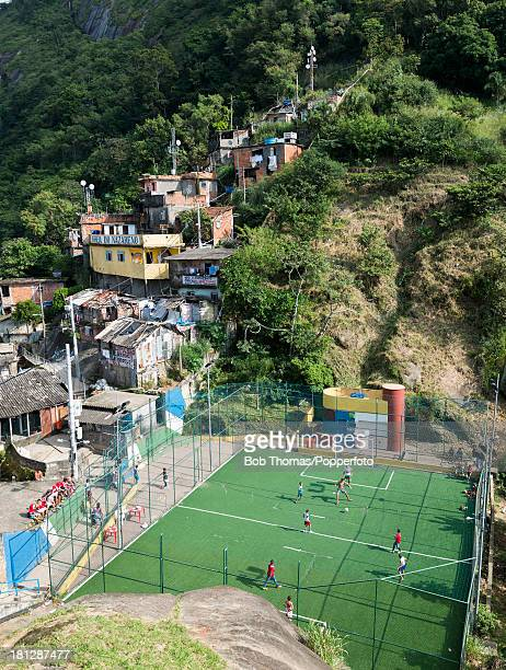 Children playing on the small football pitch in the favela of Santa Marta in Rio de Janeiro Brazil on the 8th June 2013