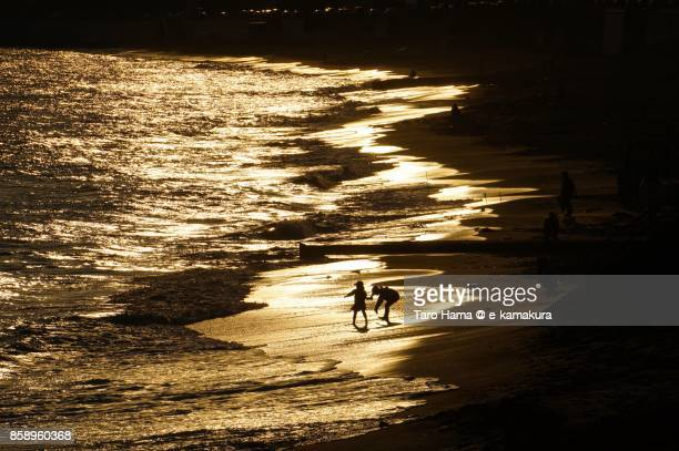 Children playing on the sunset beach in Kamakura city in Kanagawa prefecture in Japan