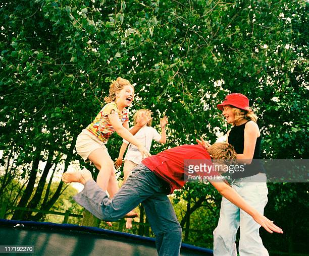 Children playing on trampoline