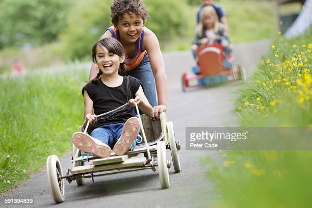 Children playing on two go-karts