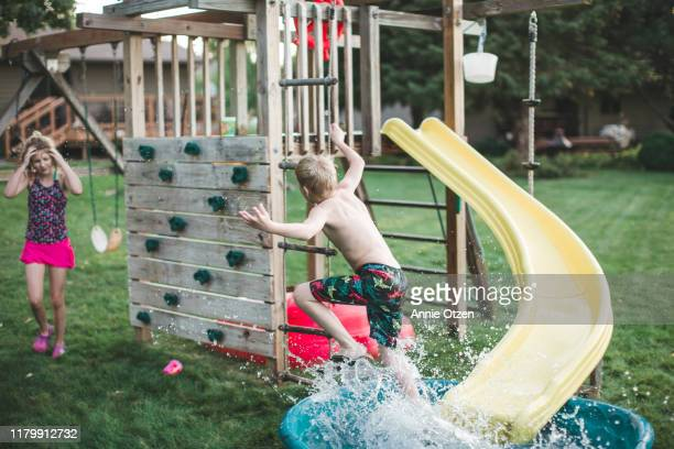 children playing outside during the summer - annie sprinkle stock pictures, royalty-free photos & images
