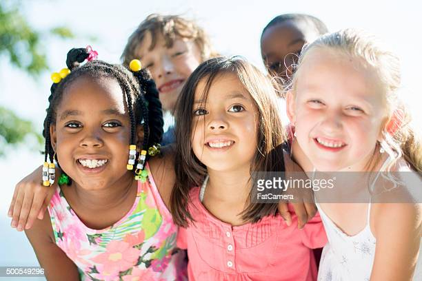 children playing outside on a sunny day - 13 year old black girl stock photos and pictures