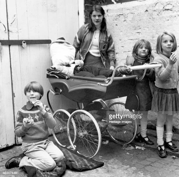 Children playing 'Penny for the Guy' in a London yard Oct 1978