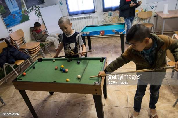 CAMP KRNJACA BELGRADE SERBIA Children playing pool in a class room during break time in a Serbian refugee camp With Hungary and Croatia stopping...