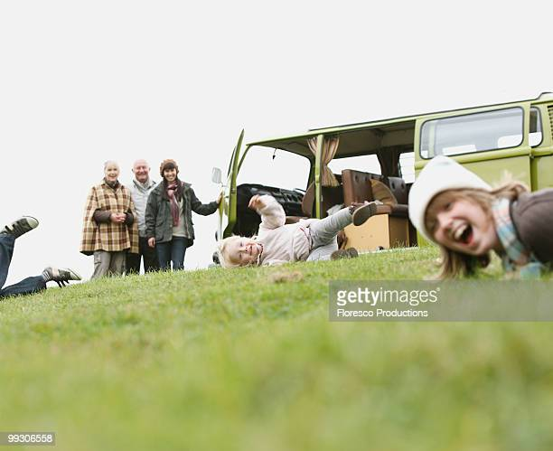 children playing rolley polley - british granny stock photos and pictures