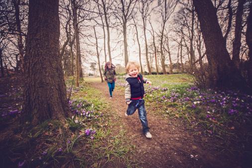 Children playing running through the woods - gettyimageskorea