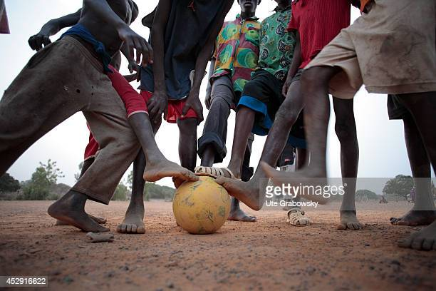 Children playing soccer on a dusty ground on April 20 in Fada N'gourma Burkina Faso