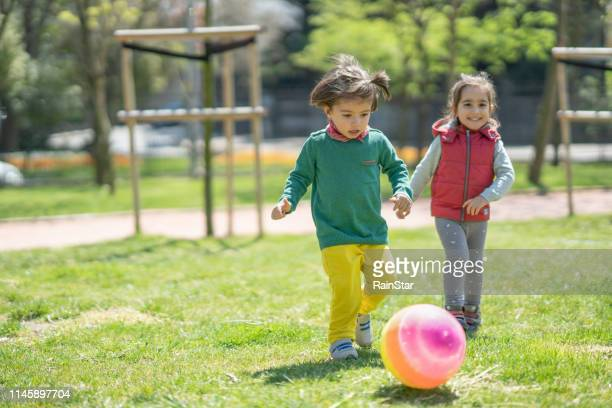 children playing soccer - kicking stock pictures, royalty-free photos & images