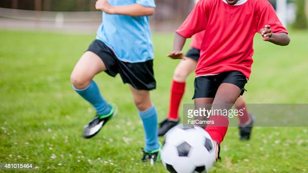 children playing soccer - scoring a goal stock pictures, royalty-free photos & images