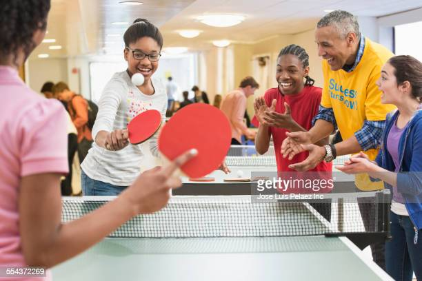 children playing table tennis in community center - community centre stock pictures, royalty-free photos & images