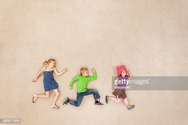 children playing tag - tag game stock photos and pictures