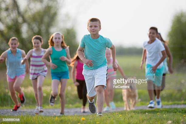 children playing tag - kids playing tag stock photos and pictures