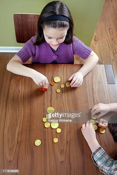 Children playing the dreidel game.
