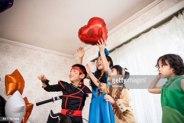 Children playing to get balloons.
