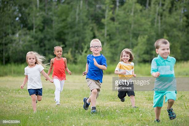 children playing together at recess - kids playing tag stock photos and pictures