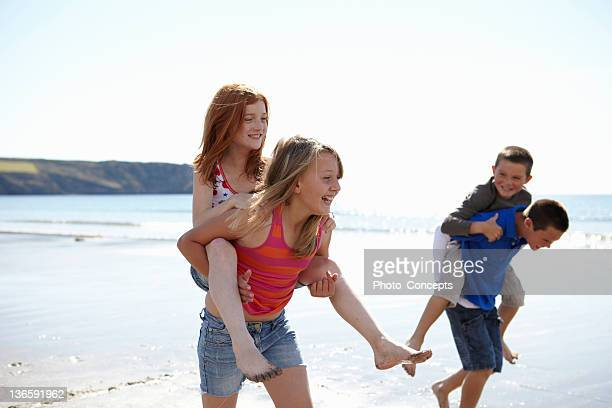 children playing together on beach - cornwall england stock pictures, royalty-free photos & images