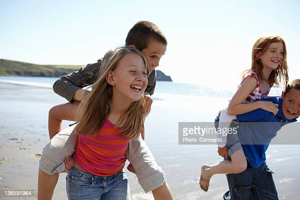 Children playing together on beach