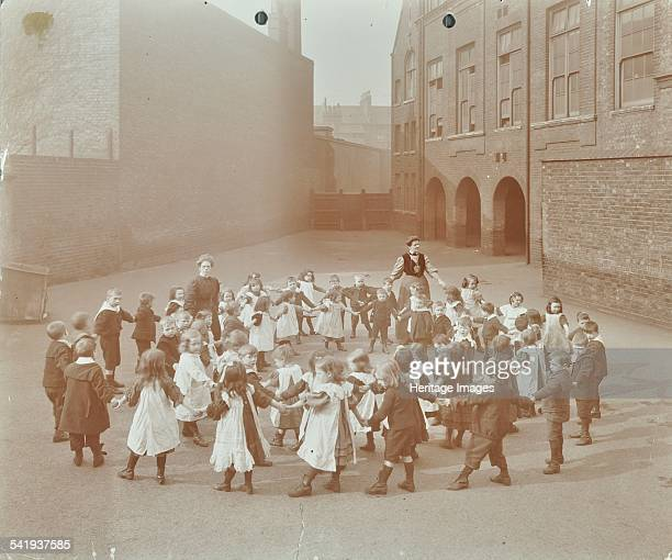 Children playing 'Twinkle Twinkle Little Star' Flint Street School Southwark London 1908 Children hold hands and form circles as they play a dancing...