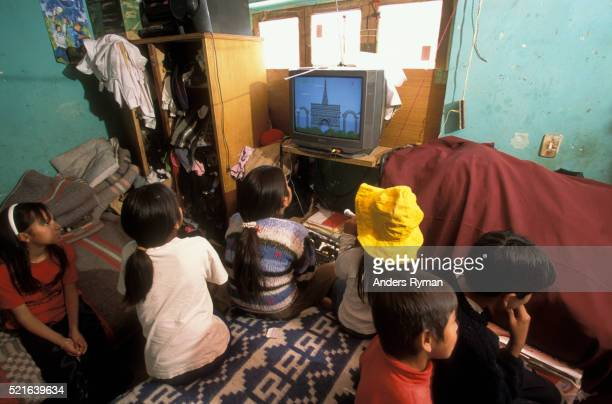 Children Playing Video Game in Bedroom