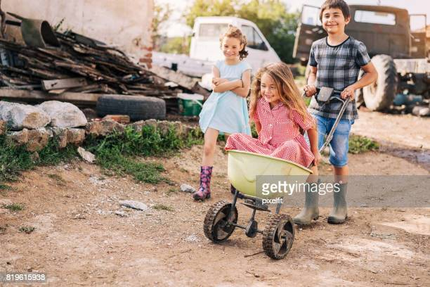 children playing with a cart - ghetto trash stock pictures, royalty-free photos & images