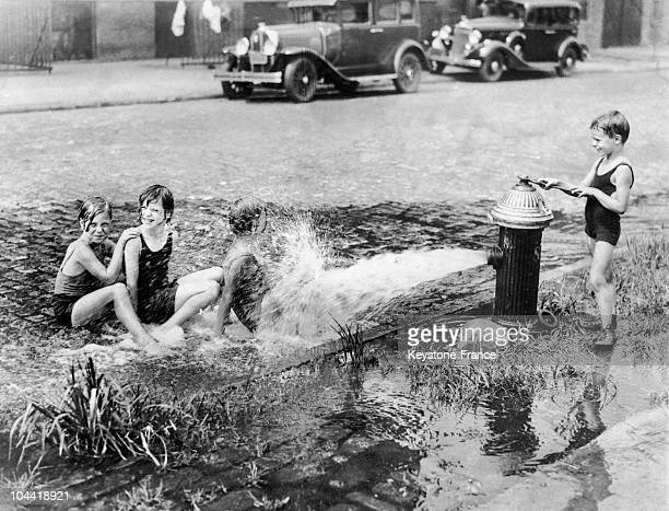 Children Playing With A Fire Hydrant In A Street Of New York On February 8 1933