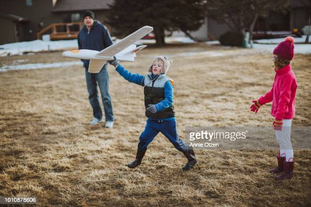 Children Playing With a Toy Airplane
