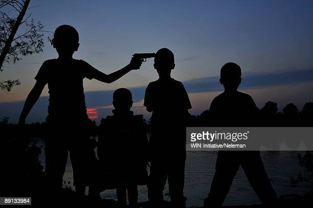 children playing with a toy gun, dnieper river, kiev, ukraine - face off stock pictures, royalty-free photos & images