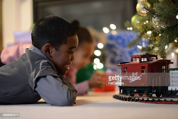 Children Playing with a Toy Train