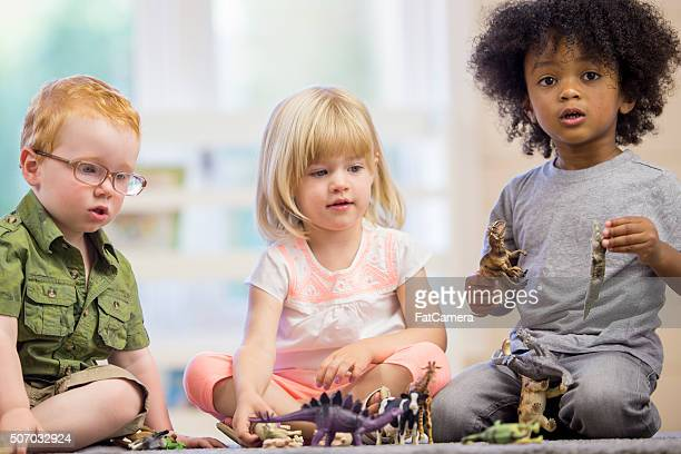 children playing with animal toys - black ginger baby stock photos and pictures