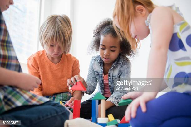 Children playing with blocks on floor