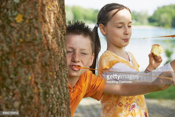 Children playing with bubble gums, Bavaria, Germany