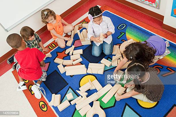 Children playing with building blocks