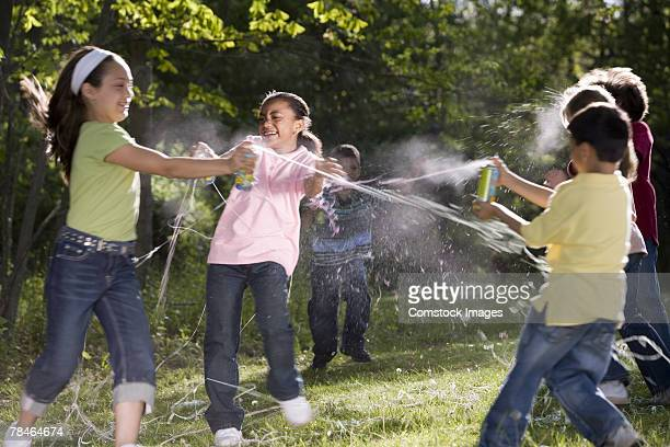 Children playing with canned confetti string