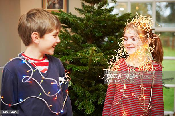 Children playing with Christmas lights