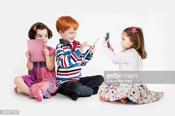 Children playing with computer technology