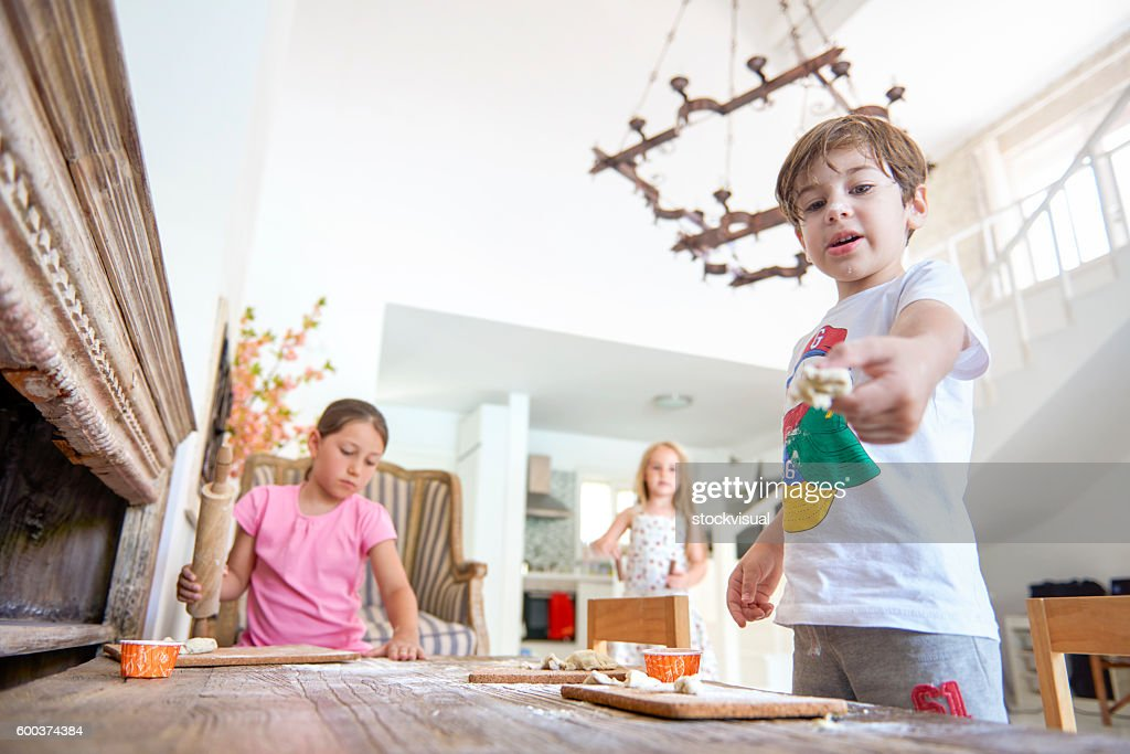 Children playing with dough on table : Stock Photo