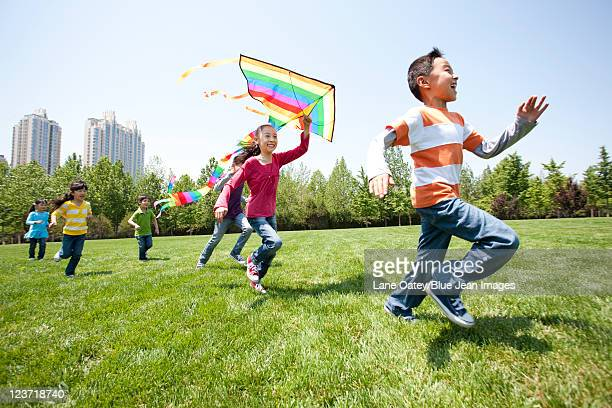 Children Playing with Kite in Field