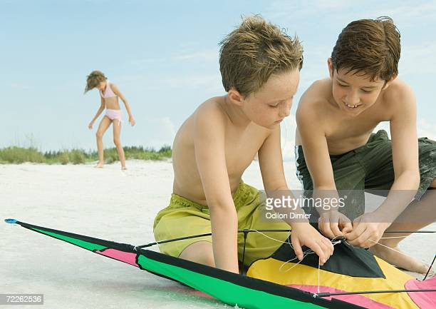 Children playing with kite on the beach