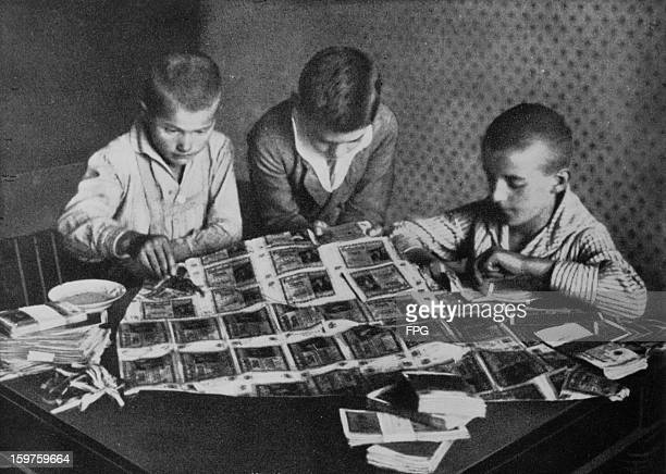 Children playing with paper money which is rendered virtually worthless by a period of postwar hyperinflation in Germany circa 1923