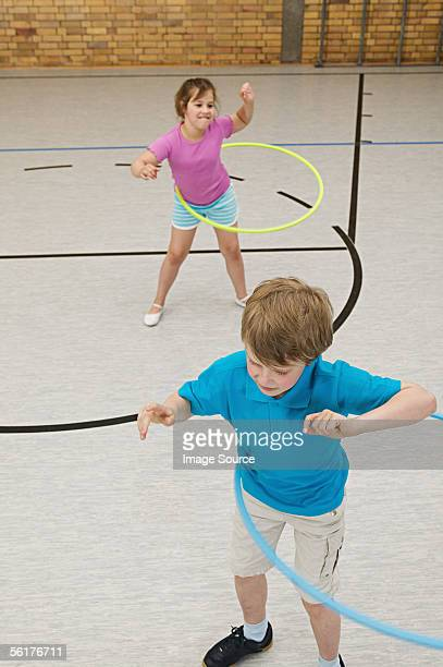 Children playing with plastic hoops