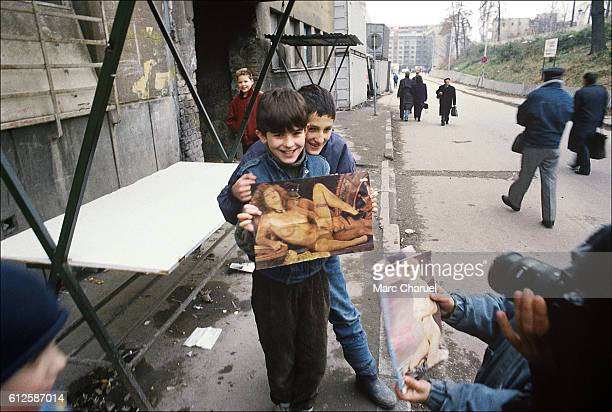 Children playing with pornographic magazines in Sarajevo