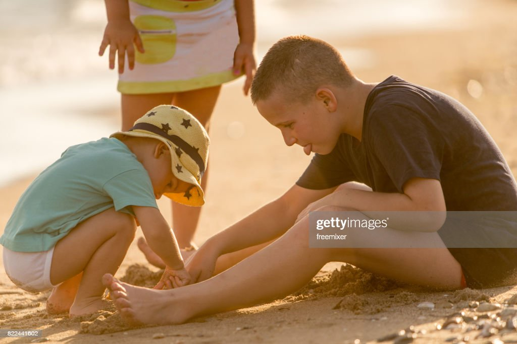 Children playing with sand : Stock Photo