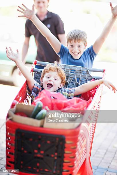 Children playing with shopping cart